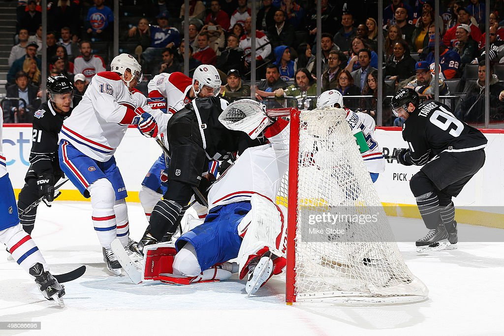 Brock Nelson #29 of the New York Islanders crashes into Carey Price #31 of the Montreal Canadiens during the game at the Barclays Center on November 20, 2015 in Brooklyn borough of New York City. The Canadiens defeated the Islanders 5-3.
