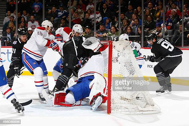 Brock Nelson of the New York Islanders crashes into Carey Price of the Montreal Canadiens during the game at the Barclays Center on November 20 2015...