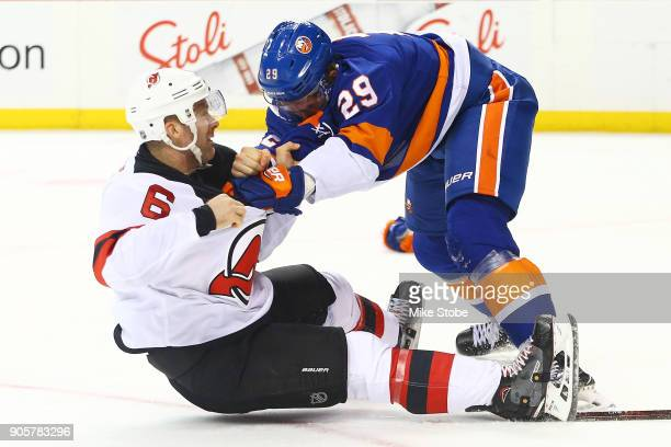 Brock Nelson of the New York Islanders gets tangled up with Andy Greene of the New Jersey Devils at Barclays Center on January 16 2018 in New York...