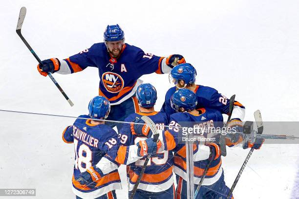 Brock Nelson of the New York Islanders is congratulated by his teammates after scoring a goal against the Tampa Bay Lightning during the second...