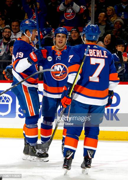 Brock Nelson of the New York Islanders is congratulated by his teammates Mathew Barzal and Jordan Eberle after scoring a first period goal against...