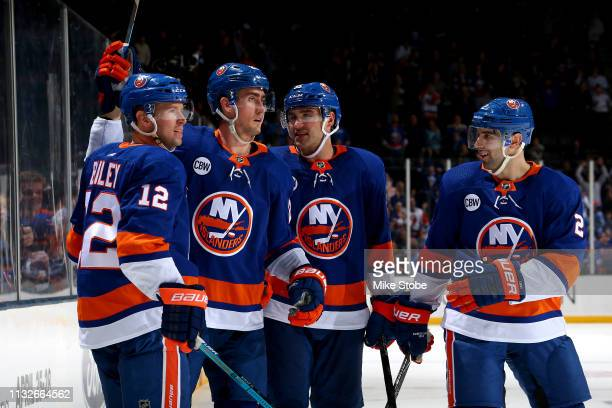Brock Nelson of the New York Islanders is congratulated by his teammates Josh Bailey Johnny Boychuk and Nick Leddy after scoring a third period goal...