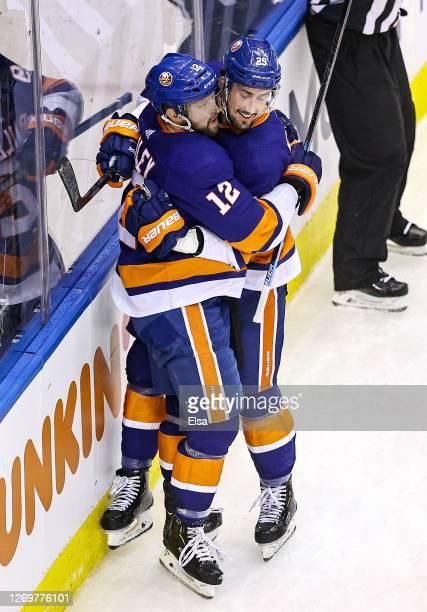 Brock Nelson of the New York Islanders is congratulated by his teammate, Josh Bailey after scoring a goal against the Philadelphia Flyers during the...