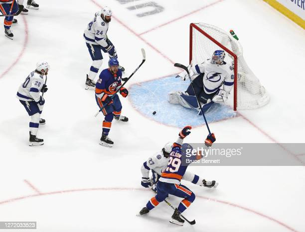 Brock Nelson of the New York Islanders is congratulated by Josh Bailey after scoring a goal against the Tampa Bay Lightning during the third period...