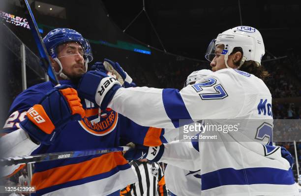 Brock Nelson of the New York Islanders is hit by Ryan McDonagh of the Tampa Bay Lightning in Game Six of the NHL Stanley Cup Semifinals during the...