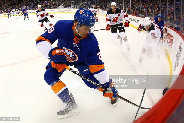 Brock Nelson of the New York Islanders pursues the puck during the game against the New York Islanders at Barclays Center on January 7 2018 in New...
