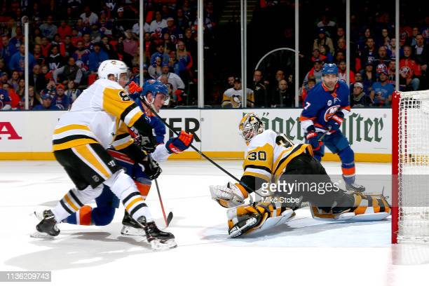 Brock Nelson of the New York Islanders scores a first period goal past Matt Murray of the Pittsburgh Penguins in Game One of the Eastern Conference...