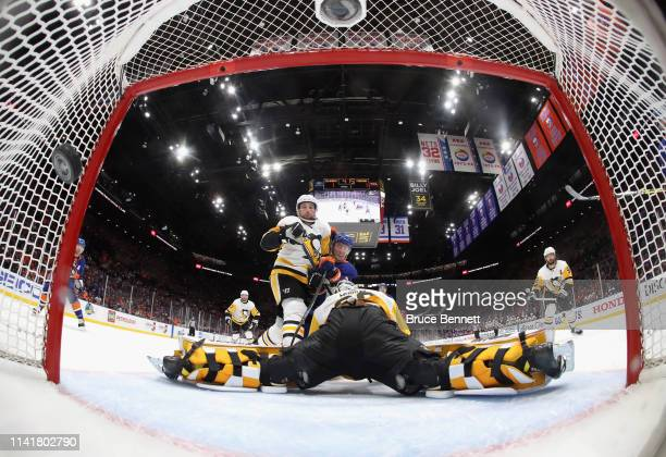 Brock Nelson of the New York Islanders scores a first period goal against Matt Murray of the Pittsburgh Penguins in Game One of the Eastern...