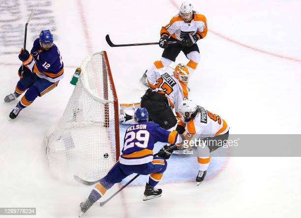 Brock Nelson of the New York Islanders scores a goal assisted by Josh Bailey past Brian Elliott of the Philadelphia Flyers during the third period in...
