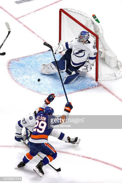 Brock Nelson of the New York Islanders scores a goal past Andrei Vasilevskiy of the Tampa Bay Lightning during the third period in Game Three of the...