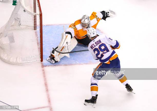 Brock Nelson of the New York Islanders scores a goal past Carter Hart of the Philadelphia Flyers during the second period in Game Seven of the...