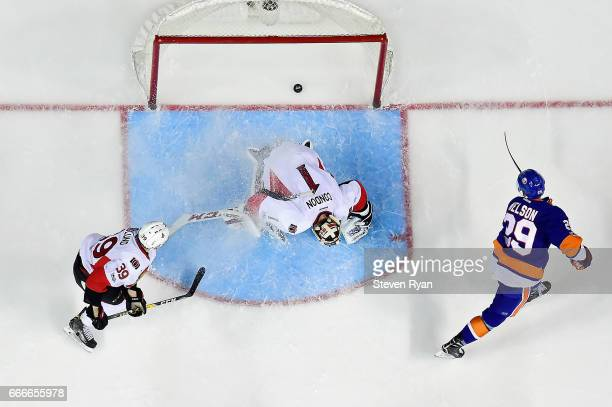 Brock Nelson of the New York Islanders scores a goal past Mike Condon of the Ottawa Senators during an NHL game at Barclays Center on April 9 2017 in...