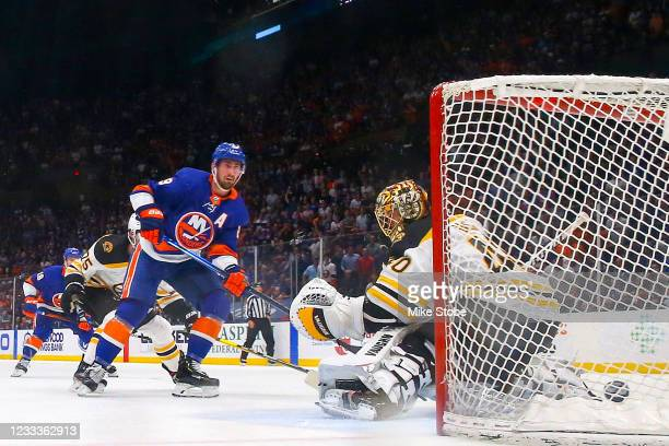Brock Nelson of the New York Islanders scores a goal past Tuukka Rask of the Boston Bruins during the second period in Game Six of the Second Round...