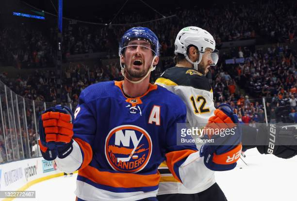 Brock Nelson of the New York Islanders scores at 12:39 of the second period against the Boston Bruins in Game Six of the Second Round of the 2021 NHL...