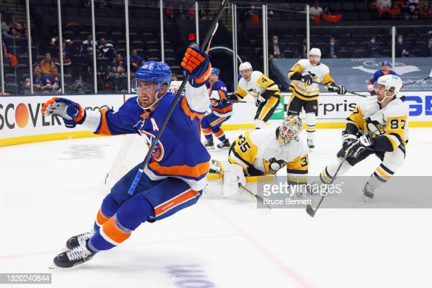 Brock Nelson of the New York Islanders scores at 8:35 of the second period against Tristan Jarry of the Pittsburgh Penguins in Game Six of the First...