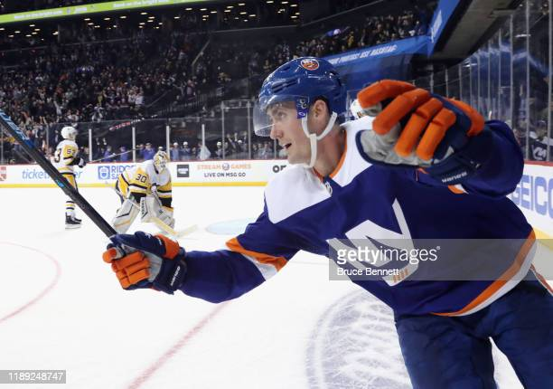 Brock Nelson of the New York Islanders scores the game winning goal at 4:16 of overtime against the Pittsburgh Penguins at the Barclays Center on...