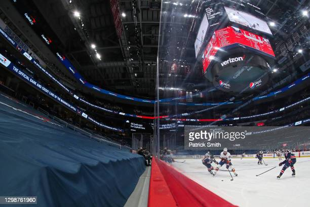 Brock Nelson of the New York Islanders skates past Nicklas Backstrom of the Washington Capitals during the first period at Capital One Arena on...