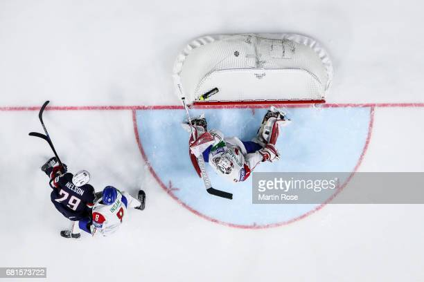 Brock Nelson of USA scores a goal to make it 2-0 against goalkeeper Andreas Bernard of Italy during the 2017 IIHF Ice Hockey World Championship game...