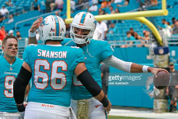 Brock Osweiler and Travis Swanson of the Miami Dolphins prepare for the NFL game against the New York Jets on November 4, 2018 at Hard Rock Stadium...