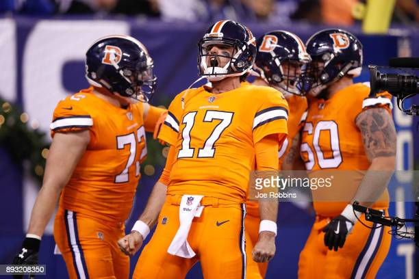 Brock Osweiler of the Denver Broncos celebrates with teammates after a touchdown against the Indianapolis Colts during the second half at Lucas Oil...