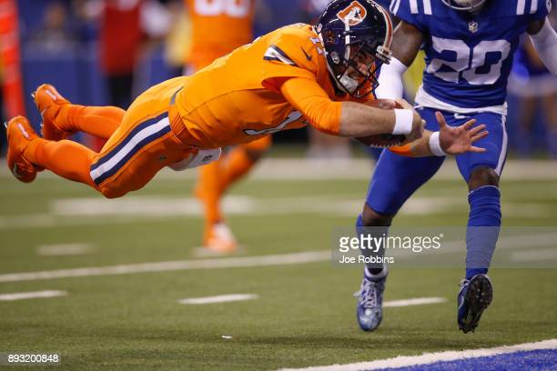 Brock Osweiler of the Denver Broncos dives into the end zone for a touchdown against the Indianapolis Colts during the first half at Lucas Oil...