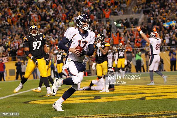 Brock Osweiler of the Denver Broncos rushes for a 7 yard touchdown during the second quarter of the game against the Pittsburgh Steelers at Heinz...