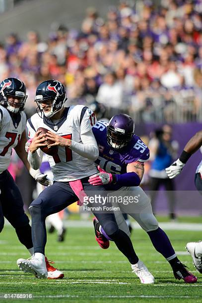 Brock Osweiler of the Houston Texans avoids a sack by Brian Robison of the Minnesota Vikings during the game on October 9, 2016 at US Bank Stadium in...