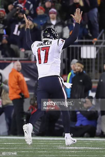 Brock Osweiler of the Houston Texans celebrates after CJ Fiedorowicz scored in the second quarter against the New England Patriots during the AFC...