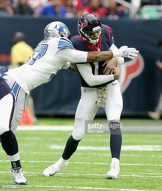 Brock Osweiler of the Houston Texans flinches as he is sacked by Armonty Bryant of the Detroit Lions at NRG Stadium on October 30 2016 in Houston...