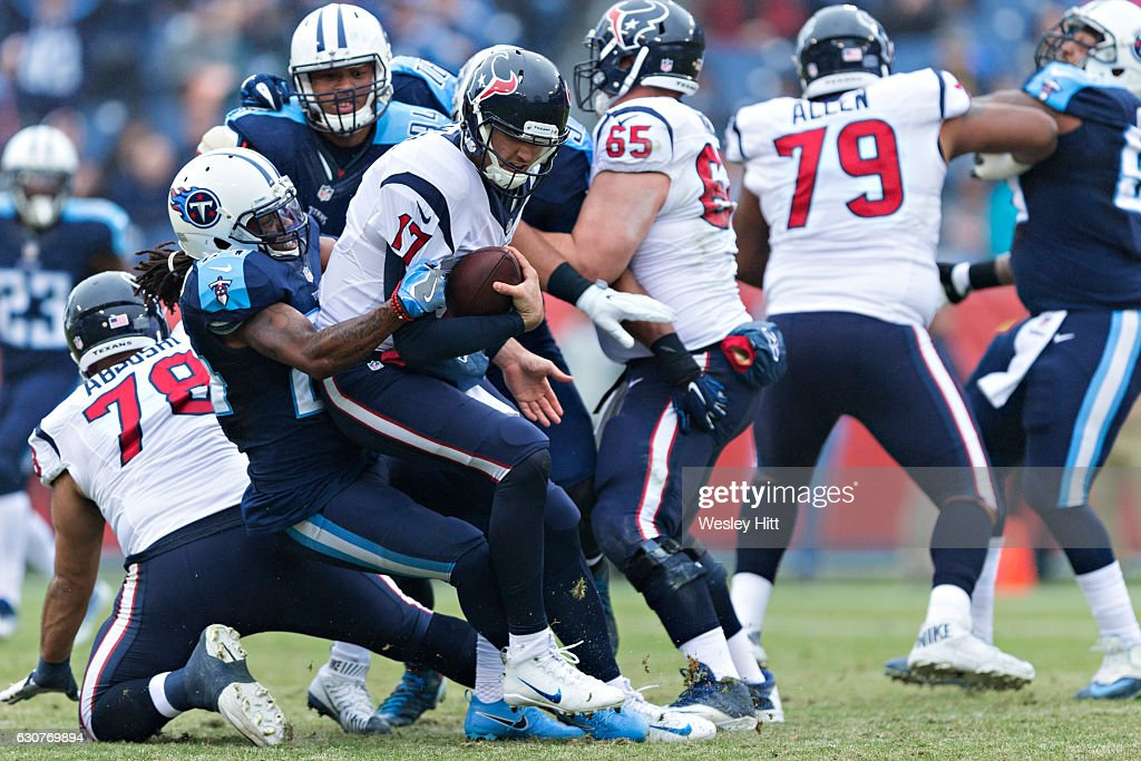 Brock Osweiler #17 of the Houston Texans is sacked by Daimion Stafford #24 of the Tennessee Titans at Nissan Stadium on January 1, 2017 in Nashville, Tennessee. The Titans defeated the Texans 24-17.
