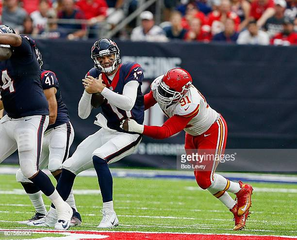 Brock Osweiler of the Houston Texans is sacked by Tamba Hali of the Kansas City Chiefs in the fourth quarter at NRG Stadium on September 18 2016 in...