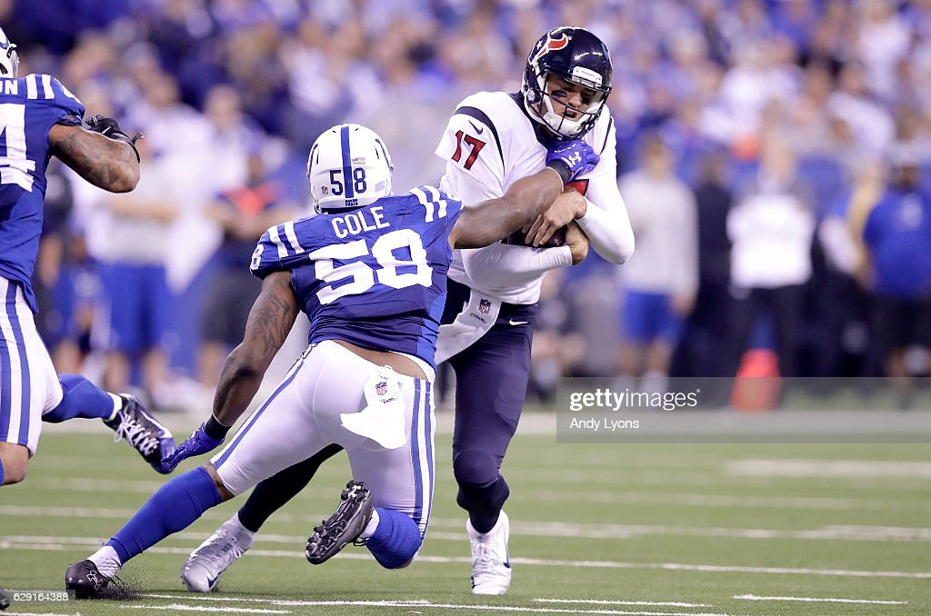 Brock Osweiler #17 of the Houston Texans is sacked by Trent Cole #58 of the Indianapolis Colts at Lucas Oil Stadium on December 11, 2016 in Indianapolis, Indiana.