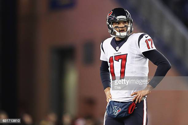 Brock Osweiler of the Houston Texans looks on in the second half against the New England Patriots during the AFC Divisional Playoff Game at Gillette...