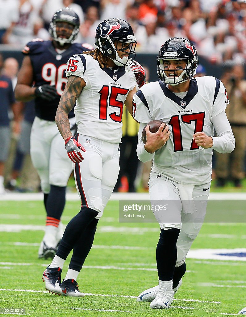 Brock Osweiler #17 of the Houston Texans reacts after running for a large gain as Will Fuller #15 looks on during a NFL football game at NRG Stadium on September 11, 2016 in Houston, Texas.