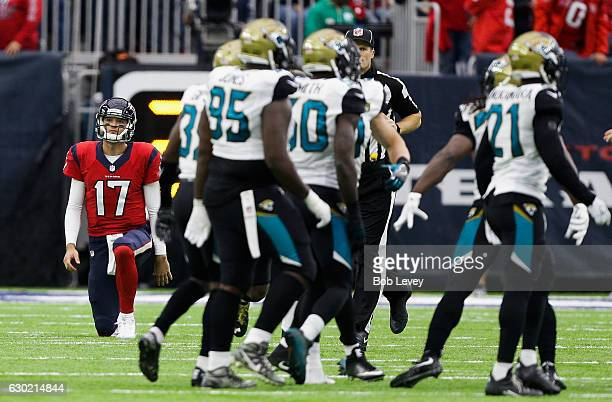 Brock Osweiler of the Houston Texans reacts after throwing an interception in the second quarter against the Jacksonville Jaguars at NRG Stadium on...