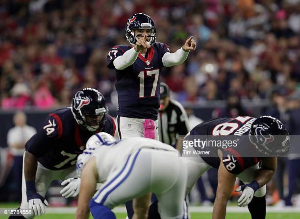Brock Osweiler of the Houston Texans signals at the line of scrimmage during the NFL game between the Indianapolis Colts and the Houston Texans at...