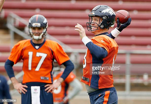 Brock Osweiler watches Peyton Manning of the Denver Broncos throw the ball during the Broncos practice for Super Bowl 50 at Stanford University on...