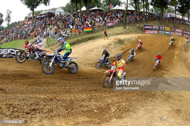 Brock Papi Kyle Endriss and Nathen LaPorte in the 250 Class Moto 2 climb a hill during the Lucas Oil Pro Motorcross Budds Creek National National on...