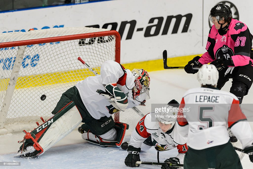 Brock Perry #57 of the Blainville-Boisbriand Armada scores on goaltender Alexis Gravel #1 of the Halifax Mooseheads during the QMJHL game at the Centre d'Excellence Sports Rousseau on October 15, 2016 in Boisbriand, Quebec, Canada.