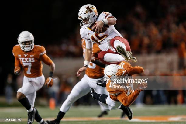 Brock Purdy of the Iowa State Cyclones attempts to hurdle P.J. Locke III of the Texas Longhorns in the fourth quarter at Darrell K Royal-Texas...