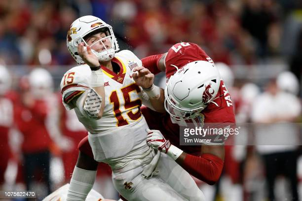 Brock Purdy of the Iowa State Cyclones is hit after throwing a pass by Willie Taylor III of the Washington State Cougars in the third quarter during...