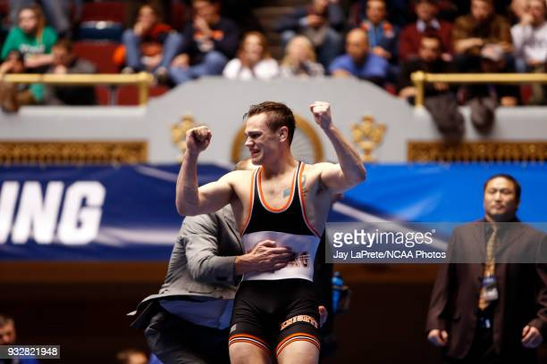 Brock Rathbun of Wartburg celebrates after winning his match in the 133 weight class during the Division III Men's Wrestling Championship held at the...