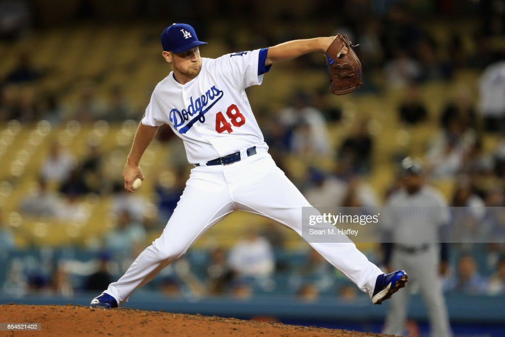 Brock Stewart #48 of the Los Angeles Dodgers pitches during the ninth inning of a game against the San Diego Padres at Dodger Stadium on September 26, 2017 in Los Angeles, California.