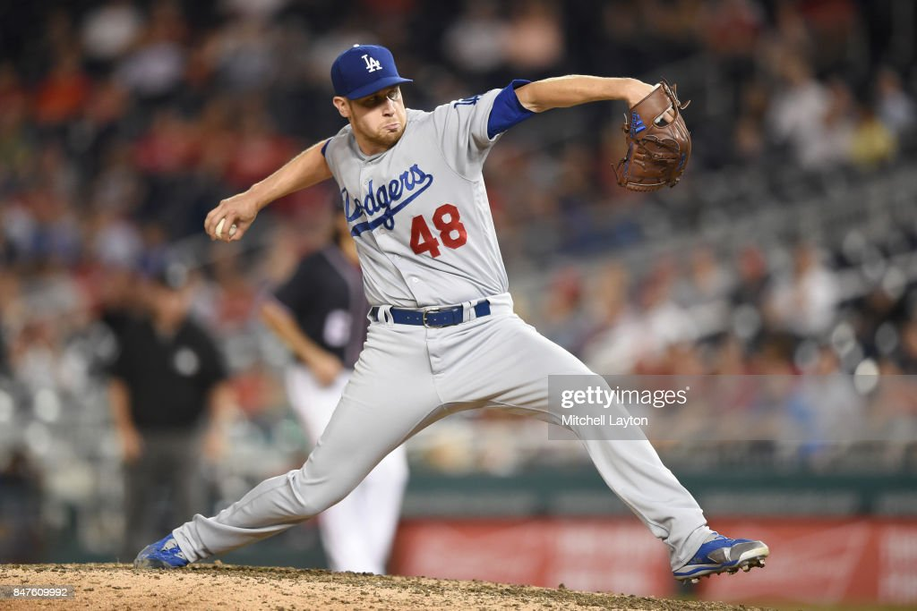 Brock Stewart #48 of the Los Angeles Dodgers pitches in the ninth inning during a baseball game against the Washington Nationals at Nationals Park on September 15, 2017 in Washington, DC.