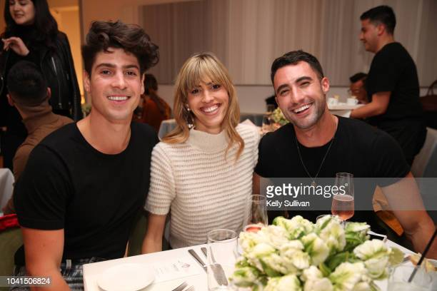 Brock Williams Kendall Chase and Christopher Lin pose for a photo at the opening of Freds at Barneys New York San Francisco on September 26 2018 in...