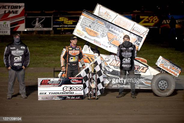 Brock Zearfoss and crew celebrate winning the 410 Sprint Car during the Open Wheel Nationals at Park Jefferson Speedway on April 25, 2020 in North...