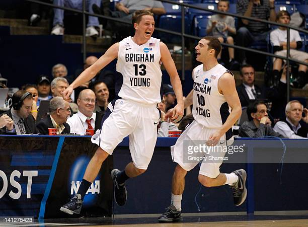 Brock Zylstra and Matt Carlino of the Brigham Young Cougars react late in the second half while taking on the Iona Gaels in the first round of the...
