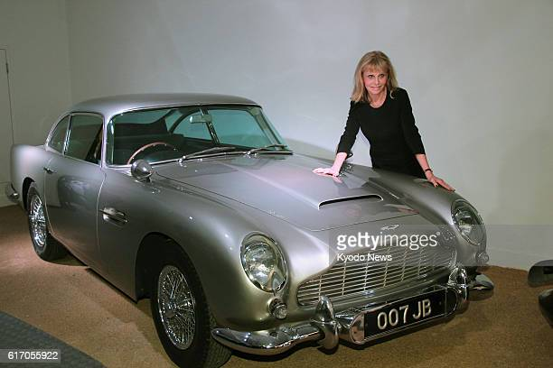 Brockenhurst Britain Britt Ekland who appeared in the 1974 James Bond film ''The Man with the Golden Gun'' poses beside an Aston Martin DB5 used in...