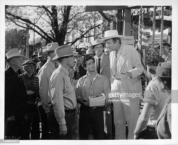 Broderick Crawford and John Derek looking up at reporter John Ireland in a scene from the film 'All The King's Men', 1949.