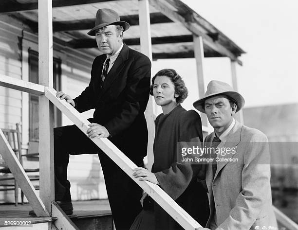 Broderick Crawford as Willie Stark Anne Seymour as Lucy Stark and John Ireland as Jack Burden in the 1949 crime drama All the King's Men